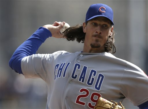 Chicago Cubs starting pitcher Jeff Samardzija (29) throws against the Pittsburgh Pirates in the first inning of their opening day baseball game on Monday, April 1, 2013, in Pittsburgh. (AP Photo/Gene J. Puskar)